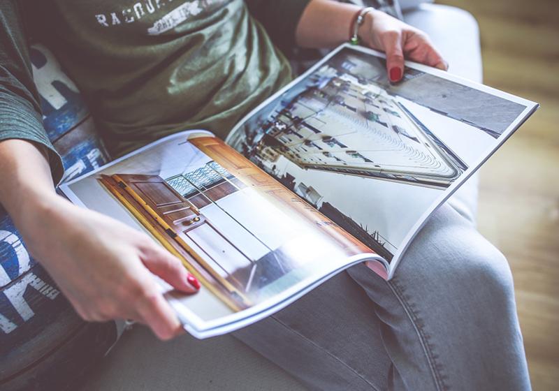 Reading a Magazine - Necessary Baby Stuff