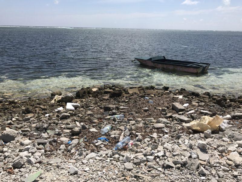 Picking up trash on Maafushi Maldives